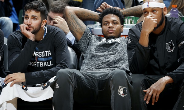 Ricky Rubio, Brandon Rush and Adreian Payne sat on the bench late in the fourth quarter. Utah beat Minnesota by a final score of 112-103. ] CARLOS GON