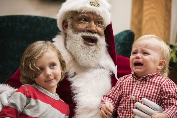 Santa Larry Jefferson smiles with Auden Good, 4, and his 1-year-old brother Ezra of Ramsey during photos at the Santa Experience at Mall of America.