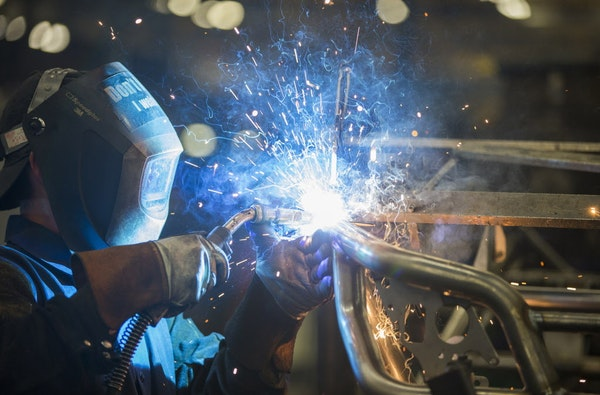 A worker welds the frame for the 2016 Wildcat X side-by-side vehicle at the Arctic Cat factory in Thief River Falls, Minn. in 2015.