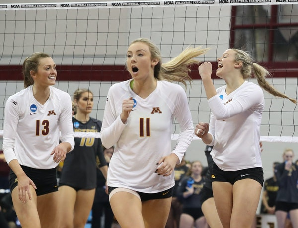The University of Minnesota's Molly Lohman (13), Samantha Seliger-Swenson (11) and Paige Tapp (4) celebrate a point against the University of Missouri