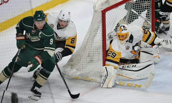 Mikko Koivu aims to score as Brian Dummoulin and goalie Marc-Andre Fleury defend.