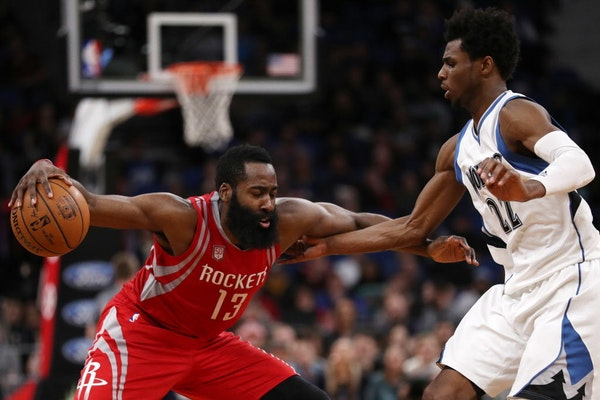 Minnesota Timberwolves forward Andrew Wiggins (22) tries to defend against Houston Rockets guard James Harden (13) in overtime. ] ANTHONY SOUFFLE �