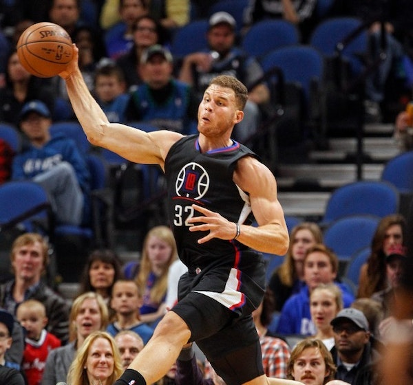 Los Angeles Clippers forward Blake Griffin (32) tries to save a loose ball Saturday night at Target Center.
