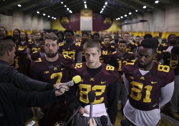 Gophers wide receiver Drew Wolitarsky, center, flanked by quarterback Mitch Leidner, left, and tight end Duke Anyanwu, read the statement on behalf of