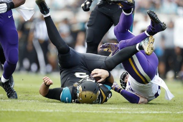 Minnesota Vikings defensive end Brian Robison (96) sacked Jacksonville Jaguars quarterback Blake Bortles (5) in the first quarter at EverBank field Su