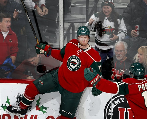 Wild center Eric Staal, left, celebrated with winger Zach Parise after scoring to boost Minnesota's lead to 3-0 in the second period Tuesday night.