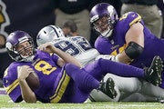 Vikings quarterback Sam Bradford (8) was sacked by Cedric Thornton (92) in the fourth quarter.