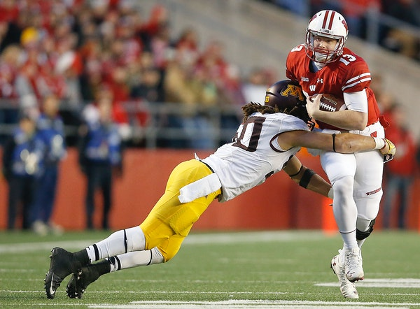 Gophers linebacker Jack Lynn tackled Wisconsin quarterback Bart Houston in the third quarter Saturday.