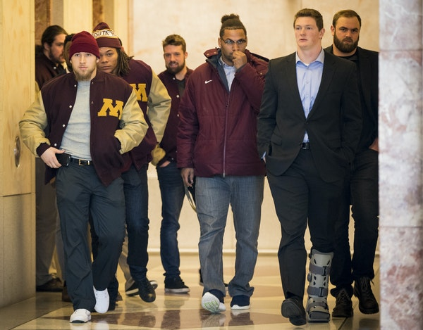 Gophers football players, none who have been suspended, walked out of a lawyer's office in Minneapolis early Friday.