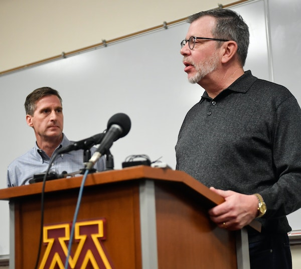 University President Eric Kaler, with athletic director Mark Coyle at his side, spoke to the media Saturday after players announced the end of their b