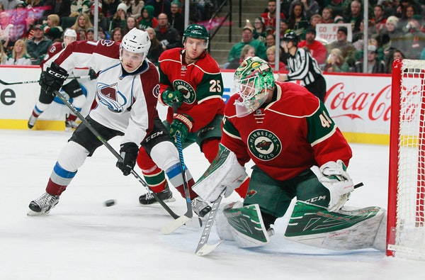 Colorado Avalanche center John Mitchell (7) looks for a rebound as Minnesota Wild goalie Devan Dubnyk (40) makes a save during the second period of an
