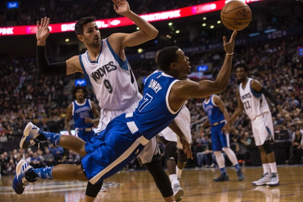Toronto Raptors guard Kyle Lowry (7) makes a play in front of Minnesota Timberwolves guard Ricky Rubio (9) during the first half of an NBA basketball