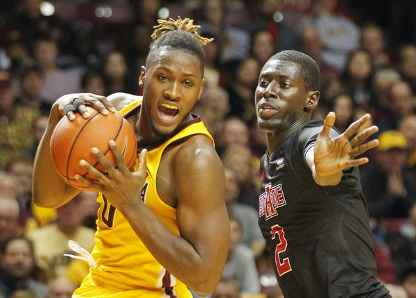 Arkansas State guard Salif Boudie covered Gophers guard Akeem Springs in the first half Friday night at Williams Arena.