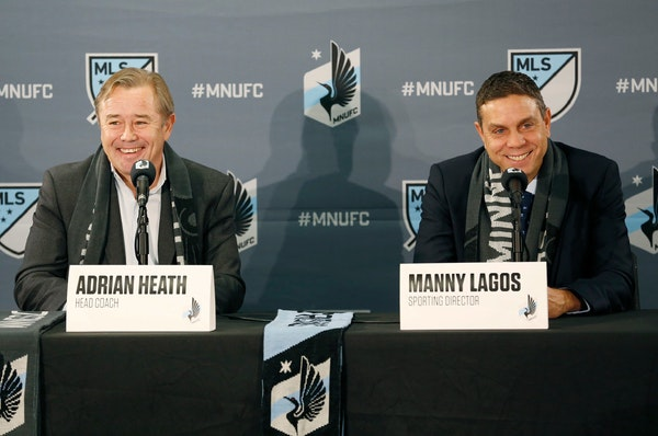New Minnesota United FC coach Adrian Heath (left) was introduced by club Sporting Director Manny Lagos at a news conference on Nov. 29 at the club's o