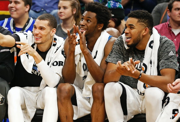 Minnesota Timberwolves' Zach LaVine, left, Andrew Wiggins, center and Karl-Anthony Towns.