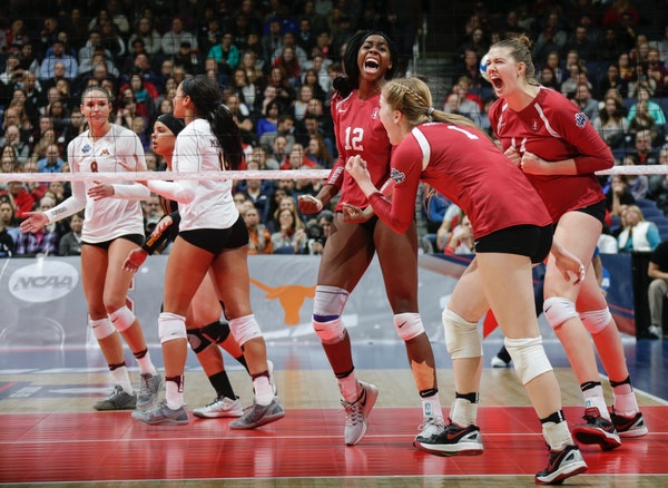 Stanford's Inky Ajanaku (12), Jenna Gray (1) and Halland McKenna (14) react after a point during the second set against Minnesota in an NCAA women's v