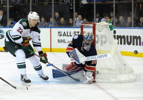 Minnesota Wild's Nino Nierderreiter, left, pressures New York Rangers goaltender Henrik Lundqvist as Lundqvist deflects the puck during the first peri