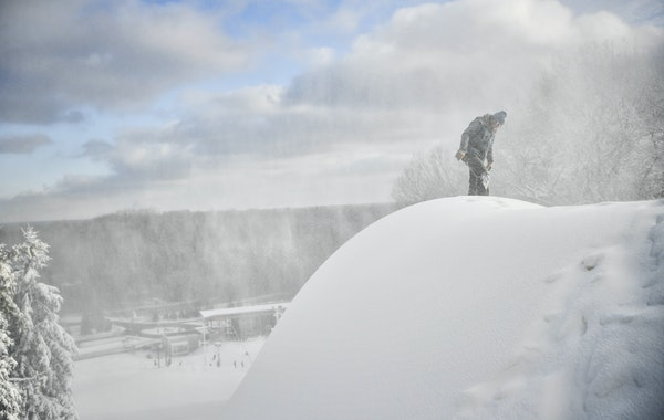 Hyland Hills snowmaker Jack Bees checked the snow at the top of a ski run Friday.