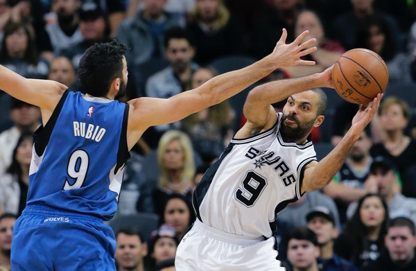 Spurs guard Tony Parker, right, looked to pass as Timberwolves guard Ricky Rubio defended during the first half Monday night.