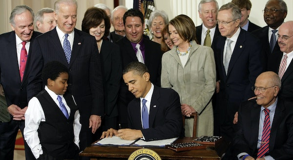 FILE - In this March 23, 2010, file photo, President Barack Obama signs the health care bill in the East Room of the White House in Washington. The Af