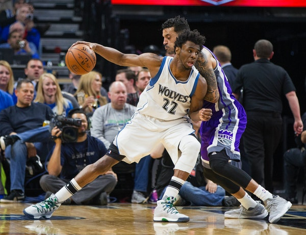 The Wolves' Andrew Wiggins drove against Kings forward Matt Barnes during the second half Friday night.