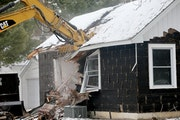 Last December, crews demolished the one-bedroom house on the corner lot that once belonged to Danny Heinrich, The vacant lot has been given as a gift