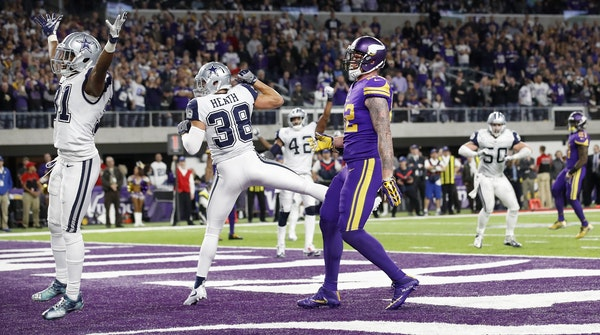 Cowboys defenders celebrated after a pass sailed past Kyle Rudolph (82) on a two point conversion attempt late in the fourth quarter last week.