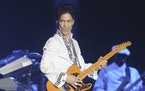 """Prince, shown at Coachella in 2008. The late rock star's estate is planning """"Paisley Park in Your Heart 2020,"""" an open-air exhibit with Prince a"""