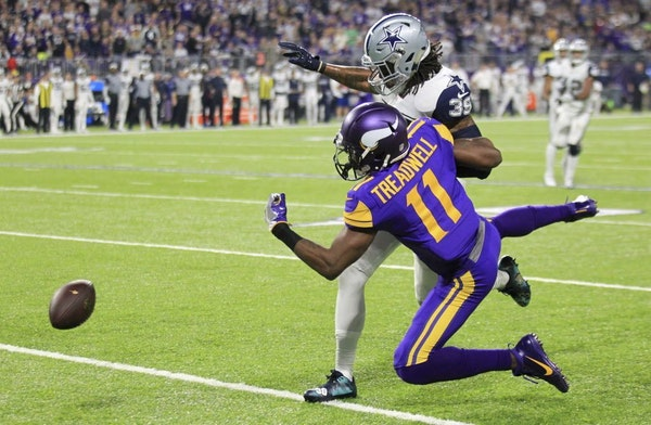 Dallas Cowboys cornerback Brandon Carr (39) breaks up a pass intended for Minnesota Vikings wide receiver Laquon Treadwell (11) during the second half
