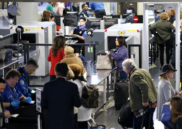 Travelers lined up at a security checkpoint at O'Hare International Airport, which ranks among the worst in the U.S.