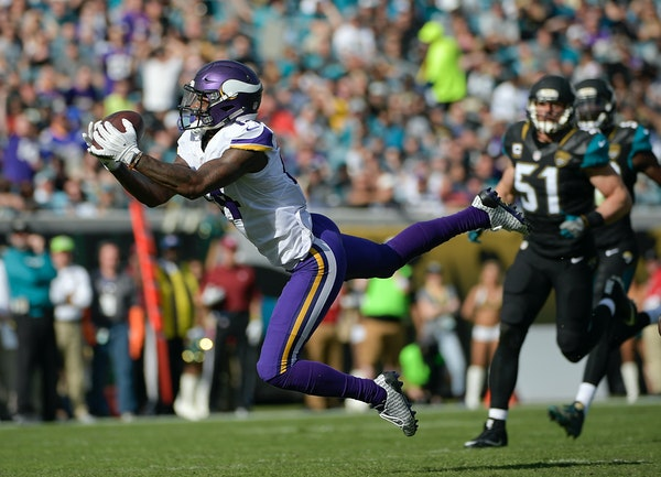 Minnesota Vikings wide receiver Stefon Diggs, left, catches a pass in front of Jacksonville Jaguars middle linebacker Paul Posluszny (51) during the f