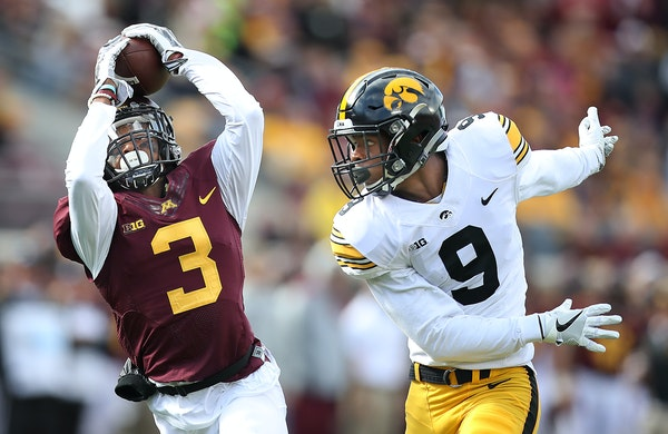 Minnesota's defensive back KiAnte Hardin intercepted a pass intended for Iowa's wide receiver Jerminic Smith in the first quarter as Minnesota took on