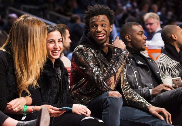 Minnesota Timberwolves Andrew Wiggins, center, laughs during the NBA all-star skills competition in Toronto on Saturday, Feb. 13, 2016. (Mark Blinch/T
