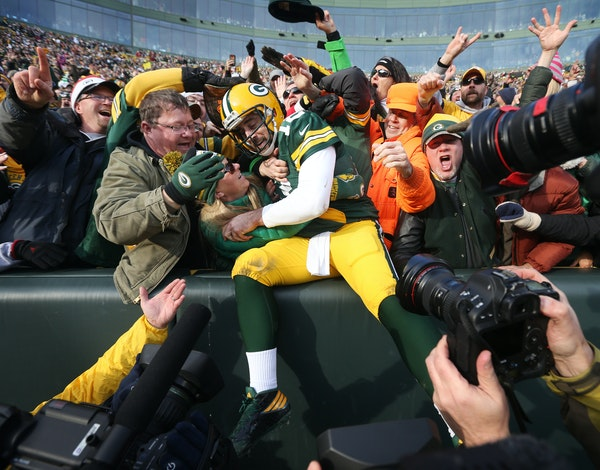 Green Bay Packers quarterback Aaron Rodgers (12) celebrated his second quarter rushing touchdown with fans at Lambeau Field Saturday December 24,2016