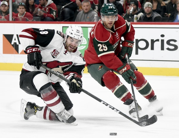 Arizona Coyotes left wing Jordan Martinook (48) and Minnesota Wild right wing Jason Pominville (29) go after the puck during the second period of an N