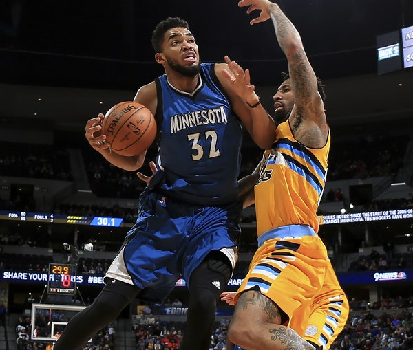 Karl-Anthony Towns, driving on Denver's Wilson Chandler on Wednesday, was a playmaker for much of the game before scoring 11 fourth-quarter points.