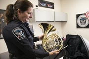 Officer Beverly Price showed off a donated french horn inside her office at Nicollet Middle School in Burnsville