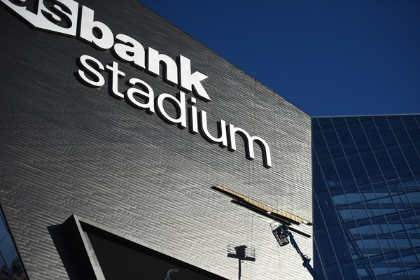 One zinc panel from U.S. Bank Stadium's problematic western prow fell to the ground early Monday while others have come loose again, leaving an abse