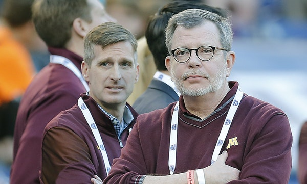 U of M President Eric Kaler, center, and AD Mark Coyle, left, will review complex circumstances in Tracy Claeys' performance.