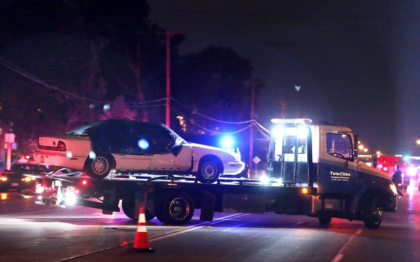 A car is towed away from the scene after Philando Castile was fatally shot in Falcon Heights.