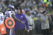 Vikings coach Mike Zimmer and cornerback Xavier Rhodes spoke on the sideline after the Packers scored on a second-quarter pass play at Lambeau Field o