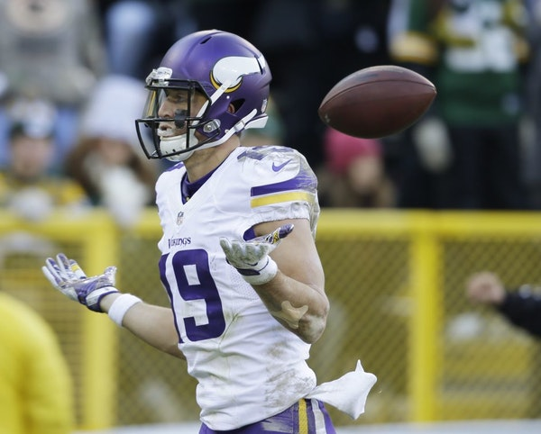 Minnesota Vikings' Adam Thielen celebrates his touchdown catch during the first half of an NFL football game against the Green Bay Packers Saturday, D