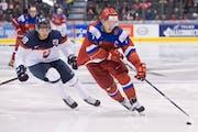 Russia's Kirill Kaprizov skated past Slovakia's Boris Sadecky in a world junior championship hockey game in Toronto on Dec. 31.