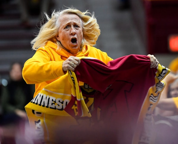 """Gophers fan Elvera """"Peps"""" Neuman ran around the court to try to get fans energized in the third quarter Saturday against the Wisconsin Badgers."""