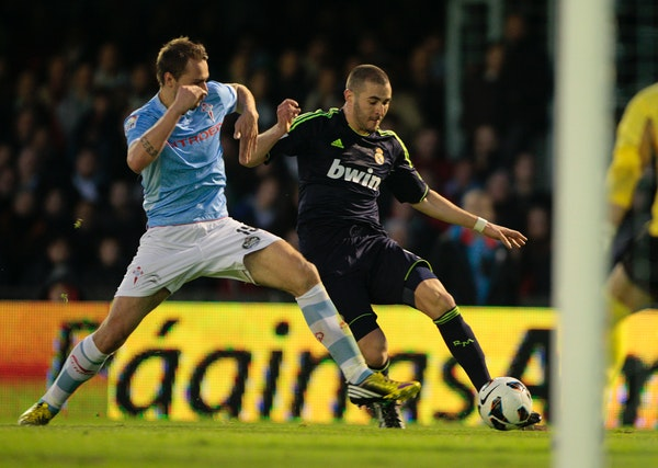 Celta's Vadim Demidov from Norway, left, in action with Real Madrid's Karim Benzema from France, during a Spanish La Liga soccer match at the Balaidos
