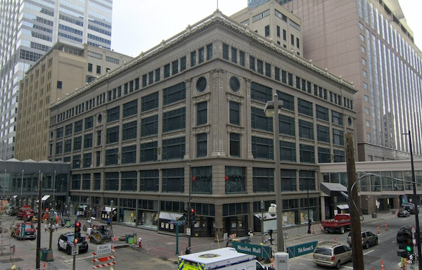 Macy's is negotiating the sale of its downtown Minneapolis property, a move that is likely to result in the downsizing or closing of its store on Ni