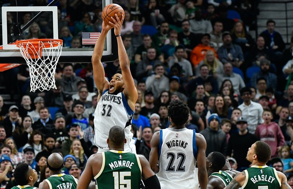 Karl-Anthony Towns (32) dunks against the Milwaukee Bucks on Friday, Dec. 30, 2016, at Target Center