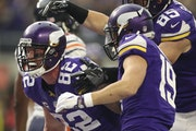 Kyle Rudolph (82), Adam Thielen (19) and Rhett Ellison came together to celebrate Rudolph's 22-yard touchdown reception in the second quarter.