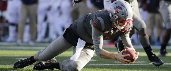 Washington State quarterback Luke Falk (4) recovers a high snap during the second half of an NCAA college football game against Arizona in Pullman, Wa