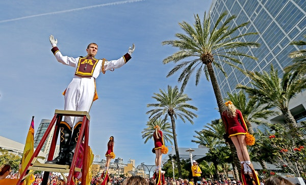Beneath palm trees on a sunny Monday in San Diego, drum major Robert Rudin and cheerleaders led the Gophers marching band. The scene off the field has